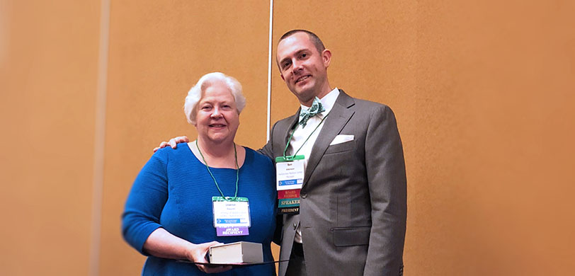 Sharon Feucht, MA, RDN, CD poses with Ben Atkinson, WSAND President, at the 2018 Ed-ucation Conference