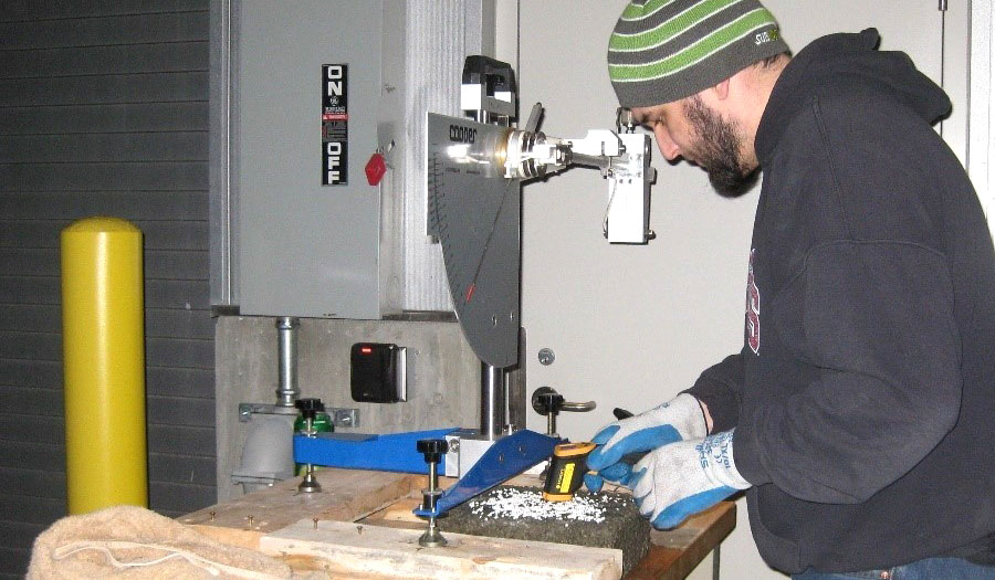 Researcher testing pavement marking materials in the laboratory